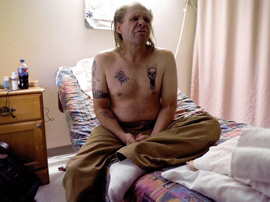 Jeffery Darling sits on his bed Wednesday in his room at Genesis Healthcare's San Juan Center in Farmington.