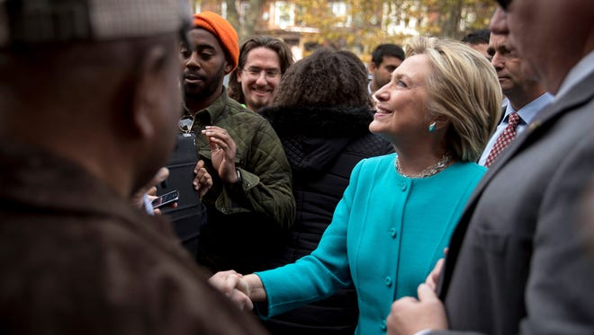 Democratic presidential candidate Hillary Clinton greets people outside Cedar Park Cafe in Philadelphia, Sunday, Nov. 6, 2016.
