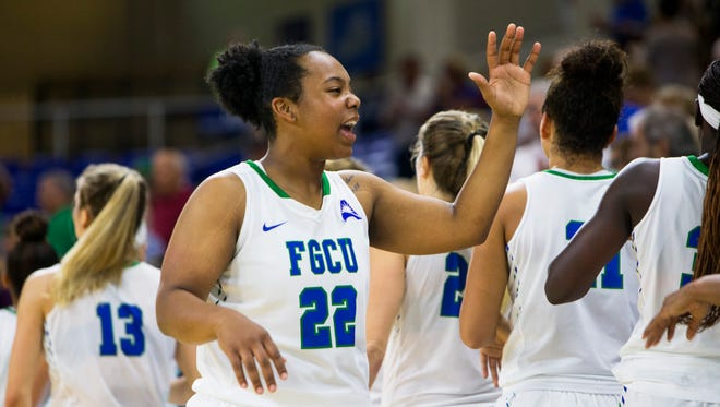 Florida Gulf Coast University junior, China Dow, #22, high fives her teammates after winning the ASUN quarterfinal game against the University of North Florida on Friday, March 3, 2017 at Alico Arena in Estero. The Eagles defeated the Ospreys 59-42, advancing to the semifinals.