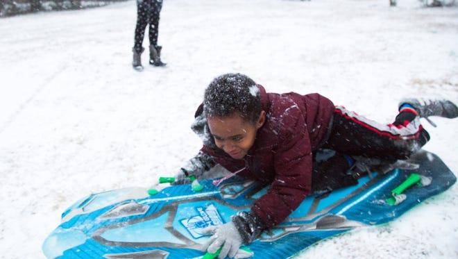 Solomon Kelley has fun in the snow in Goodlettsville on Friday evening, Jan. 12.