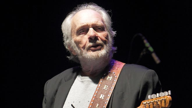 FILE - In this May 3, 2014 file photo, Merle Haggard performs in concert at Harrah?s Resort in Atlantic City, N.J. At 77, he still tours around the country about two weeks each month and recently bought a new tour bus, a sign that he?s not interested in retirement from the road. His band, the Strangers, now includes his wife, Theresa, and 21-year-old son Ben, as well as band leader Norman Hamlett, who has been with Haggard since the 1960s.