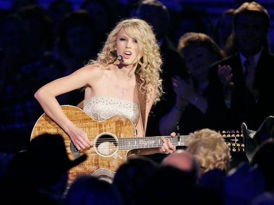 "Taylor Swift performs her song ""Tim McGraw"" to the country star sitting in the audience during the 42nd Annual Academy of Country Music Awards on Tuesday, May 15, 2007, in Las Vegas.  (AP Photo/Mark J. Terrill) ORG XMIT: NVTS133"