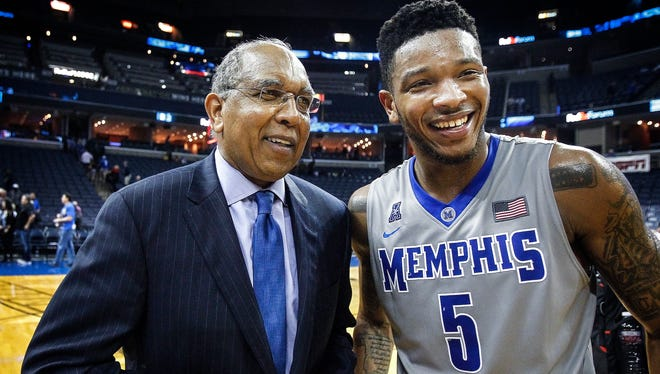 University of Memphis head coach Tubby Smith and guard Markel Crawford share a moment after the Tigers defeated Tulsa 66-44 at FedExForum.