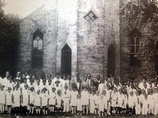 Several children and members of the Knights of Pythias and Calanthe Court pose in front of First Baptist Church around 1922. Pictured is the third building that housed First Baptist Church on East Winchester Street, erected around 1906 from bricks the Rev. Peter Vertrees purchased cheaply from an old Nashville penitentiary.