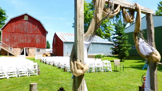 A wedding event held, Saturday, June 23, 2018, at Lot 671 barn in the town of Green Valley, Wisc. T'xer Zhon Kha/USA TODAY NETWORK-Wisconsin
