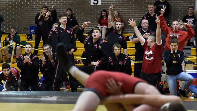 North Posey wrestlers react as teammate Levi Miller wins the 138 division of the Wrestling sectional at Central High School in Evansville Saturday.  North Posey finished second behind sectional champions Mater Dei.