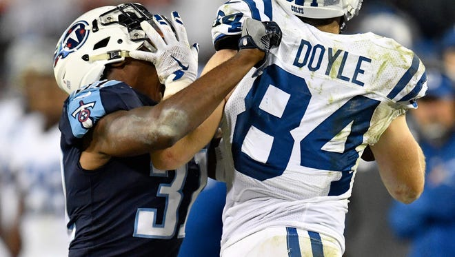Colts tight end Jack Doyle (84) pushes Titans safety Kevin Byard (31) out of bounds during the second half Monday night.