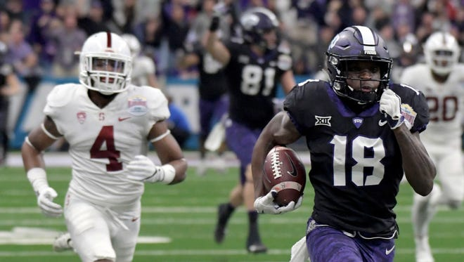 TCU Horned Frogs wide receiver Jalen Reagor (18) carries the ball past Stanford Cardinal cornerback Alameen Murphy (4) in the 2017 Alamo Bowl at the Alamodome.