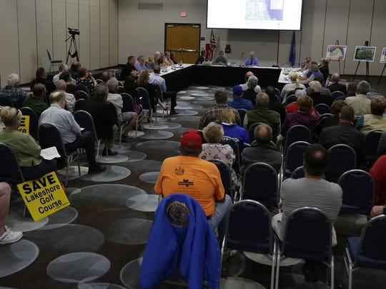 Members of the public gather Wednesday, Oct. 4, 2017, for a joint meeting of the Oshkosh Plan Commission and the Parks Advisory Board at the Oshkosh Convention Center.