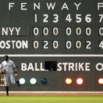 The Fenway Park scoreboard tells the story for Brett Gardner and the Yankees, who fell to the Red Sox 8-0 Saturday night. It was New York's fourth straight loss.