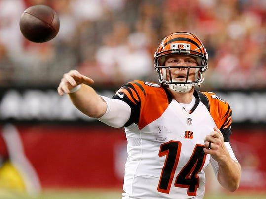Cincinnati Bengals' Andy Dalton gets off a pass against the Arizona Cardinals during the first half of an NFL preseason football game Sunday, Aug. 24, 2014, in Glendale, Ariz. (AP Photo/Ross D. Franklin)