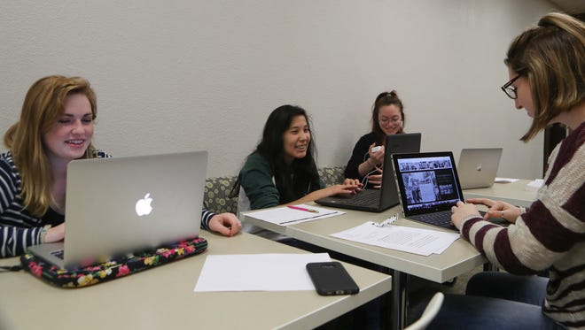 College Option and College Connection students Noelle Weyand, from left, Hope Valles, Kennedy Somavia, and Satori Wilkinson, work during a study period at Shasta College on April 21.