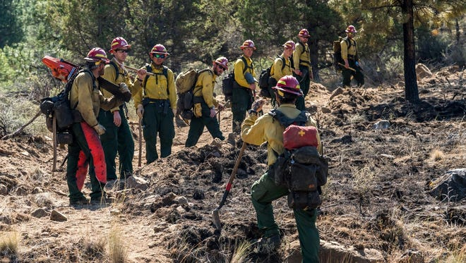 The Graham Fire stood at 85 percent contained Tuesday morning. Crews are continuing to focus on mop-up operations.