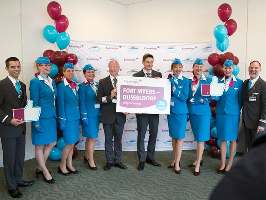 Eurowings flight crew members and officials celebrate