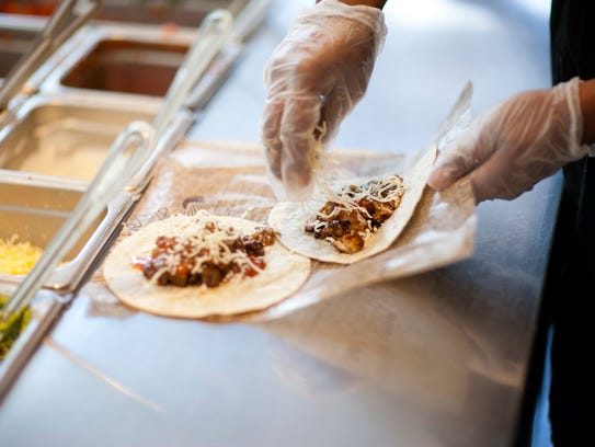 Build-your-own tacos at Chipotle Mexican Grill come