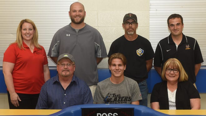 Mountain Home's Greg Aloisi (front row, center) signed a National Letter of Intent on Tuesday to play soccer at Metropolitan Community College in Independence, Mo. Accompanying Aloisi for the signing were: (clockwise, from left) his father, Ron, youth coach Stacy Helmert, MHHS assistant coach Nathan Criner, youth coach Butch Blum, MHHS head coach Bryan Mattox, and his mother, Linda.