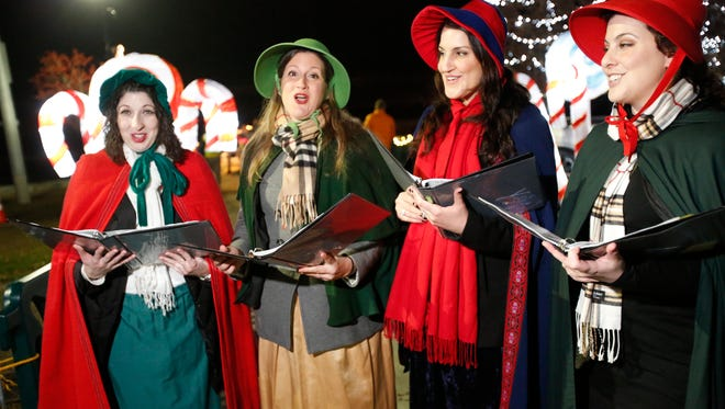 The Hope Players representing the Hope for Change Foundation sing Christmas carols at the Westchester County Winter Wonderland at Kensico Dam park on Dec. 6, 2015.