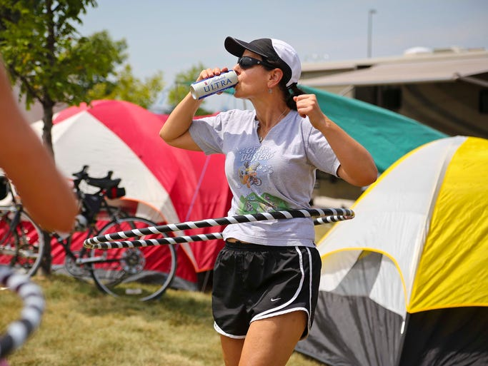 Kris Schwarz of Davenport, on her 5th RAGBRAI, starts a hula-hoop workout with Team Crop Dusters after arriving in Council Bluffs Saturday July 20, 2013 for the start of the 41st edition of RAGBRAI.