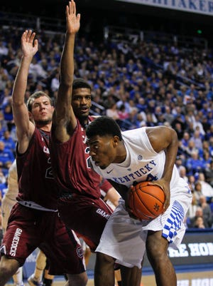 Kentucky's Dakari Johnson had 13 rebounds with 10 points and two blocks in the Wildcats' 77-43 demolishing of South Carolina Saturday. By Matt Stone, The Courier-Journal February 14, 2015