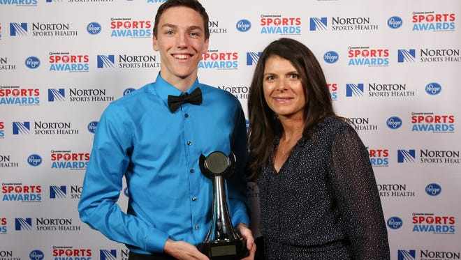 Two-time U.S. Olympic gold medalist Mia Hamm, right, posed with Eli Coker during the CJ Sports Awards.June 12, 2017