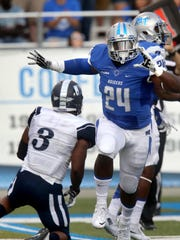 MTSU's Cavellis Luckett (24) and his teammates go toe-to-toe with Charlotte's impressive defense on Saturday.