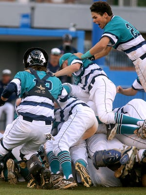 Siegel's short stop Drew Benefield (24) is on top of th heap as Siegel players dog pile on top of each other as they celebrate winning the 2016 TSSAA Class AAA State Baseball Championship over Arlington, on Friday, May 27, 2016.