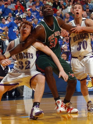 Central's John Peckinpaugh (left) and Terry Jenkins try to control Greg Oden in the first quarter of the 2006 state championship game.