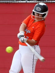 Burkburnett's Callie Riley makes contact with the ball