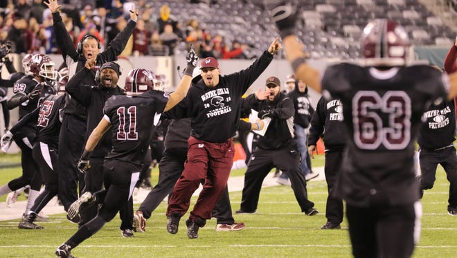 Wayne Hills celebrates their dramatic overtime win over Wayne Valley.