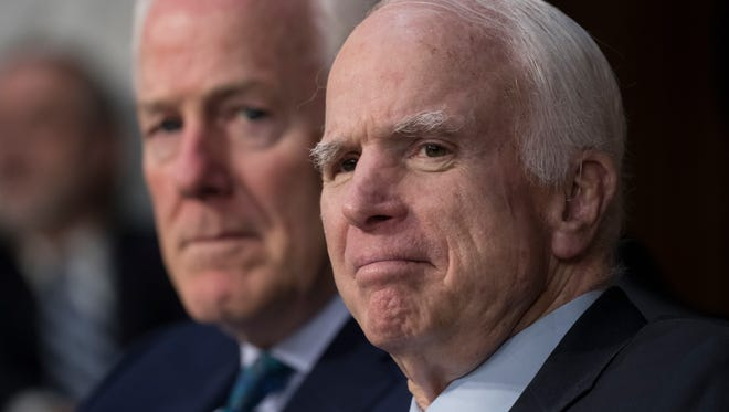 Sen. John McCain, R-Ariz., (right) with Sen. John Cornyn, R-Texas, listens as Attorney General Jeff Sessions testifies on Capitol Hill in Washington on June 13, 2017, before the Senate Intelligence Committee hearing on his role in the firing of FBI Director James Comey and the investigation into contacts between Trump campaign associates and Russia.