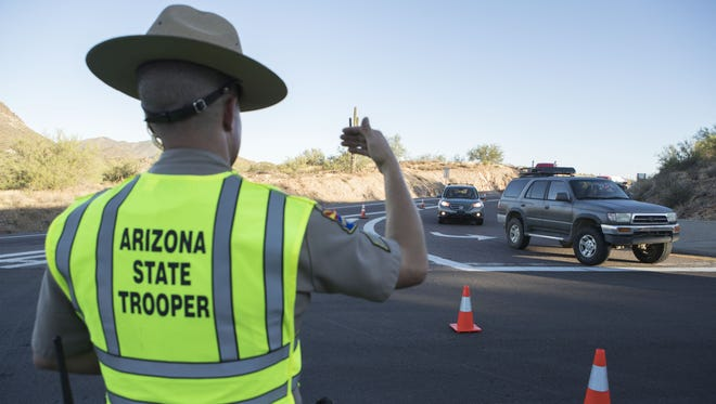 Sgt. Jason Gibbs directs traffic on Aug. 8, 2017, in New River.
