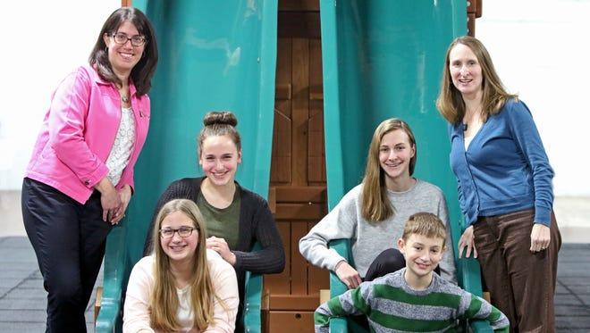 Cindy Lofy and her children, Mari (front) and Kaia, and Christine Jahn and her children, Nathan and Allyson, pose at The Big Backyard in New Berlin.