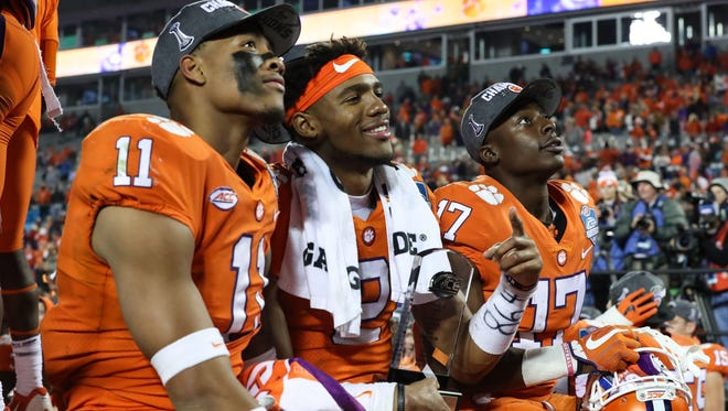 Dec 2, 2017; Charlotte, NC, USA; Clemson Tigers tight end Shadell Bell (11), quarterback Kelly Bryant (2), and  wide receiver Cornell Powell (17) watch the video board during the post game celebration of the ACC championship game between the Clemson Tigers and the Miami Hurricanes at Bank of America Stadium. Mandatory Credit: Jim Dedmon-USA TODAY Sports