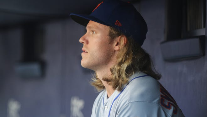 Met pitcher Noah Syndergaard in the dugout waiting to pitch in the first inning against the Yankees, Friday, July 20, 2018, at Yankee Stadium. Syndergaard is making just his second start since May 25 due to a right index finger strain.