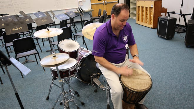 San Juan College music professor Teun Fetz plays a djembe, one of the instruments that will be featured when the college's African Drumming Ensemble performs this weekend.