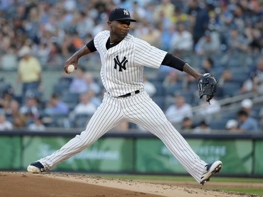 New York Yankees pitcher Domingo German throws during