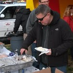 Don Denner of Ankeny, pictured, and his brother Bob offer their Boondoogle BBQ meals at area events.