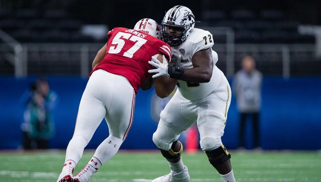 Western Michigan guard Taylor Moton (right) has the physical size to step in and play on an NFL offensive line, but his footwork is questionable. The Packers need to replace T.J. Lang at guard and will probably be looking for help at that position later this month in the NFL draft.