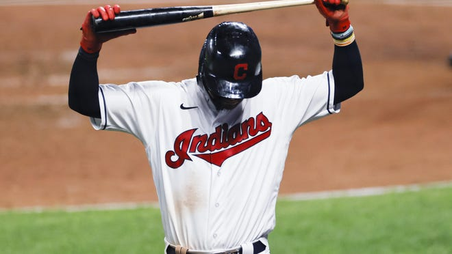 Cleveland Indians' Tyler Naquin reacts after striking out against Detroit Tigers pitcher José Cisnero during the sixth inning of a baseball game, Friday, Aug. 21, 2020, in Cleveland. The Tigers defeated the Indians 10-5.
