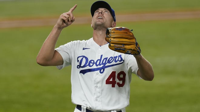 Los Angeles Dodgers relief pitcher Blake Treinen celebrates after the third out in the top of the fourth inning against the Atlanta Braves in Game 7 of the National League Championship Series on Oct. 18 in Arlington, Texas.