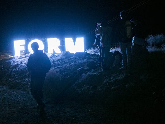 The festival sign glows at FORM Arcosanti on Sat. May.