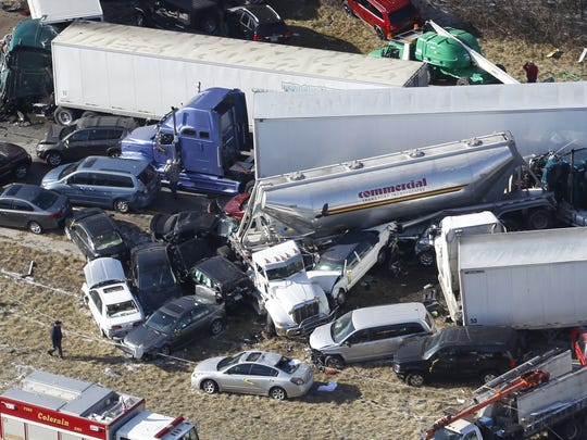 Jan.2013:  Vehicles are piled up in major crash on I-275 westbound, between the intersections of Hamilton Avenue and Colerain Avenue in Colerain Township, Monday January 21, 2013. The Enquirer/Gary Landers