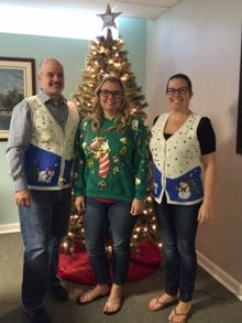 Jeffrey Smith (from left), Tiffany Wile and Ashley Minton get ready to load gifts collected during the 2015 collection.