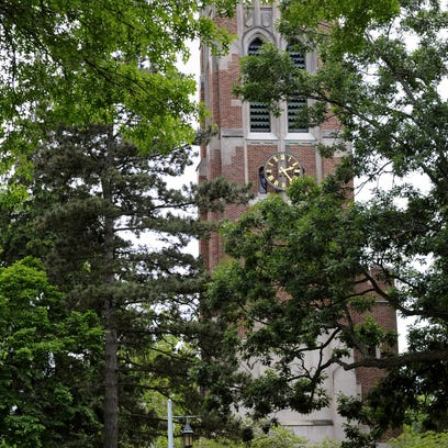 Orientation tours pass MSU's Beaumont Tower on campus in East Lansing