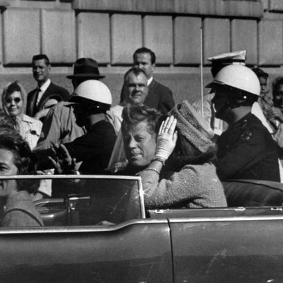 President Kennedy's motorcade approximately one minute