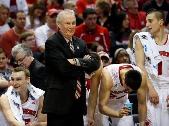 Wisconsin head coach Bo Ryan smiles during the second half of a second-round game against the American in the NCAA college basketball tournament March 20, 2014, in Milwaukee. Wisconsin won 75-35.