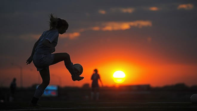Lincoln's Kennedi Keller (8) warms up before a match against O'Gorman Tuesday, Oct. 6, 2015, at McEneaney Field on the O'Gorman High School campus in Sioux Falls.