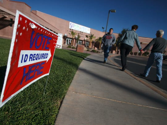 Voters make their way to the polls at the Dixie Center