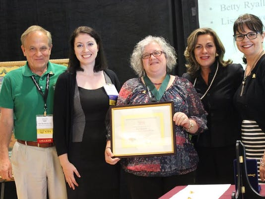 The Journey Through Hallowed Ground Partnership presented its 2015 CTA Star Award to Lisa Shower at the organization s annual conference. With Shower, center, is Kurt Burkhart, Ashley Abruzzo, Cate Magennis Wyatt and Beth Erickson.