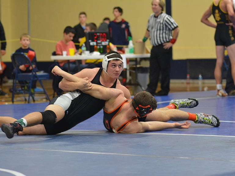Plymouth senior Hussein Youssef (left) pins an opponent at the Lincoln Duals.